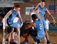 Lansing Catholic boys hold off Williamston in OT