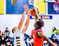 Everett boys hoops grits out win over Grand Ledge
