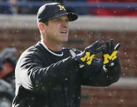 Michigan coach Jim Harbaugh headed west to have more sleepovers