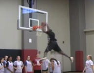 VIDEO: HS girls hoops coach throws down amazing dunk above his player