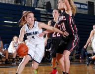 St. Johns girls hoops knocks off East Lansing