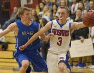 Boys basketball: Reno solidifies hold on first place