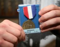 """New Jersey swimmer defines sportsmanship, gives medal to """"its rightful owner"""""""