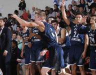 East Lansing boys fend off Everett to stay perfect