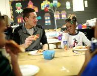Northville players bring supplies, pizza to Detroit kids