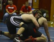 Tate Aggies win school's first district wrestling title
