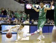 Mo. boys hoops team that wore pink socks all season in tribute win first state title