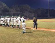 High school baseball coach proposes to girlfriend on field
