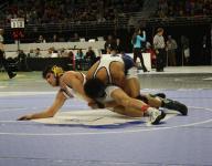 Seven defending Div. 1 champs win wrestling openers