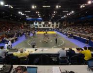 First round results from wrestling finals at The Palace