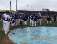 Baseball teams have fun during rain delay