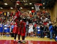 Baylor signee Mark Vital climbs over three players for jam at High School Slam