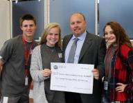 High school students surprise teacher with family medical fund donation