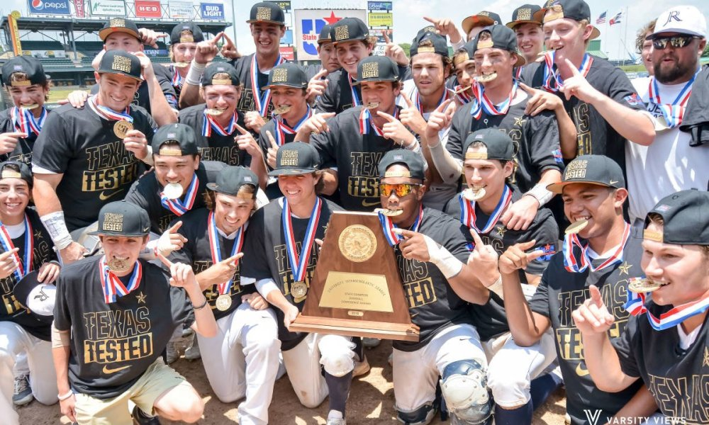 The Dallas Jesuit baseball team celebrates a state title with Nike-sponsored hats and shirts (Photo: Twitter)
