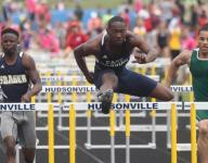 Div. 1 track: Jackson's Owens overcomes injury, breaks state record