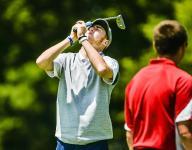 Lansing Catholic 15 strokes off state championship lead