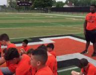 Chiefs' Andy Mulumba talks to football campers in Dearborn
