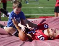 Center Grove football team makes kids' day