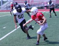 High school football teams improve in Branson heat