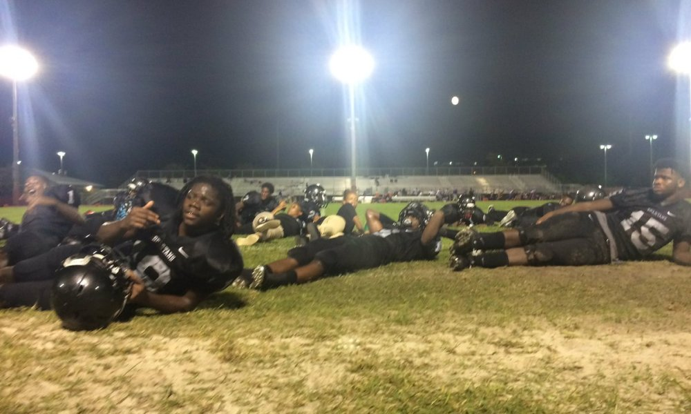 South Plantation football players laid on the turf after shots were fired in the vicinity of South Plantation Stadium (Photo: Twitter)