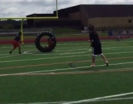 VIDEO: Minn. players connect on pass and catch using a tractor tire as a gigantic prop
