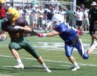 Area high school football teams scrimmage