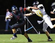 Football roundup: Jackets run wild on Red Hawks, Cougars win