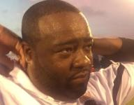 King coach Tyrone Spencer: Coach Harvel looking down smiling