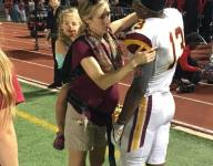 Pregnant football team physician weighs in on ultimate working mom photo