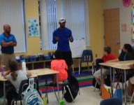 Tiger Woods isn't competing, but he is meeting with third graders