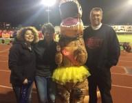 Colorado school crowns girl in T-Rex costume as Homecoming Queen