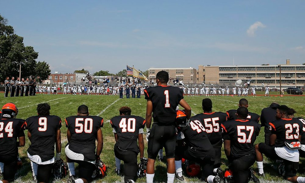Woodrow Wilson coach Preston Brown penned an op-ed explaining why he kneeled during the national anthem (Photo: Twitter)