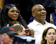 Forget ice cream. Why was Mike Tyson's 7-year-old daughter in the USTA Presidential Suite?