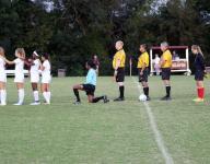 Brebeuf Jesuit player kneels during national anthem