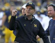 Michigan coach Jim Harbaugh joins chain gang at high school game