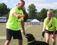 Harper Creek coach seeks success for team and dog