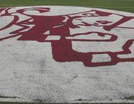 Aquinas evens record, defeats football rival McQuaid