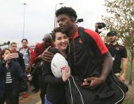Teen with cancer fulfills wish to meet Louisville quarterback Lamar Jackson