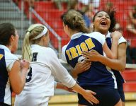 Nia Robinson joyfully leads Cathedral's volleyball team