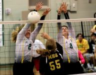 Catholic volleyball peaking with sweep of Marianna