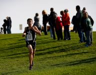Lansing Catholic boys, girls run to regional titles