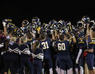 No. 6 DeWitt holds off East Lansing in district opener, 21-7