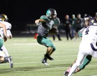 HS football: Mikesell's 4 TDs, improved D lifts Zionsville past Decatur Central