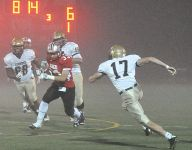 Horne runs for 4 TDs as Somers beats Lourdes 28-14