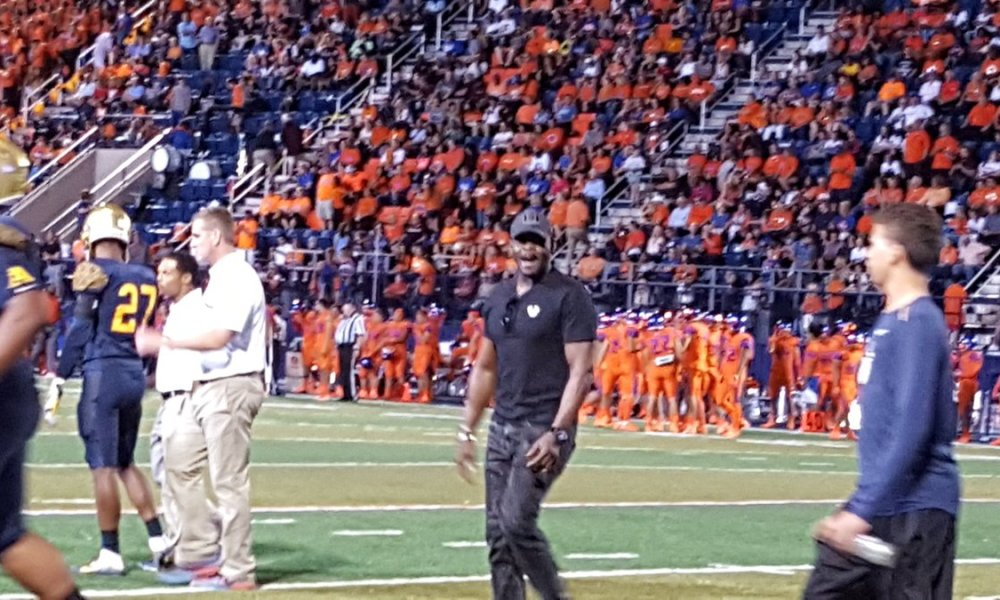 Michael Irvin was in a celebratory mood on the St. Thomas Aquinas sideline at Bishop Gorman on Friday (Photo: Twitter)