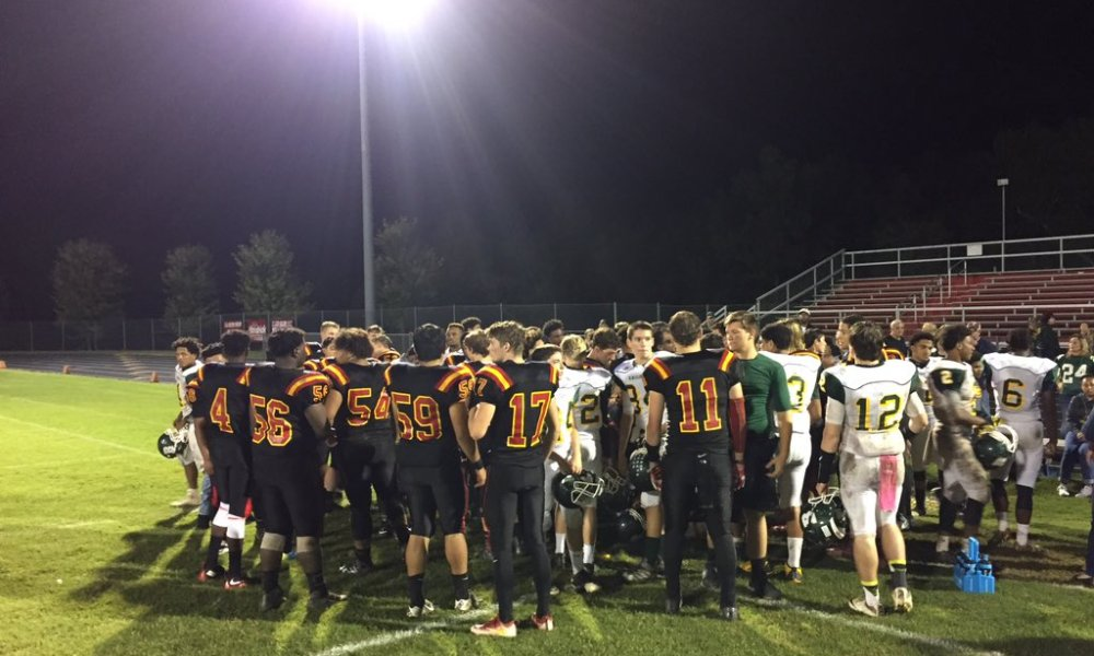 The Goochland and Buckingham football teams came together to pray for three Buckingham players who were injured on the same play (Photo: Twitter)