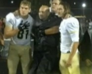 VIDEO: Suburban Chicago football coach in wheelchair gets help to stand during national anthem