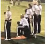 North Carolina high school football official kneels for national anthem