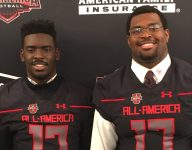 St. John's (D.C.) teammates Calvin Ashley, Tyree Johnson receive Under Armour All-America jerseys