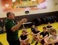 Holt community rallying around legendary wrestling coach